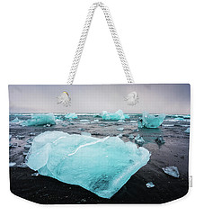 Weekender Tote Bag featuring the photograph Iceberg Pieces In Iceland Jokulsarlon by Matthias Hauser