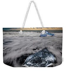 Weekender Tote Bag featuring the photograph Iceberg Remnant by Rikk Flohr