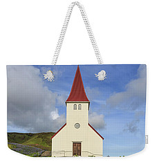 Weekender Tote Bag featuring the photograph Icelandic Church Among The Fields Of Lupine by Edward Fielding