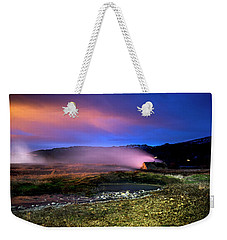 Weekender Tote Bag featuring the photograph Icelandic Geyser At Night by Dubi Roman
