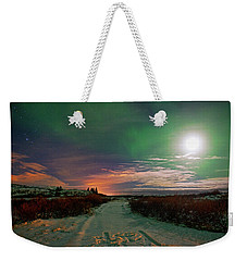 Weekender Tote Bag featuring the photograph Iceland's Landscape At Night by Dubi Roman