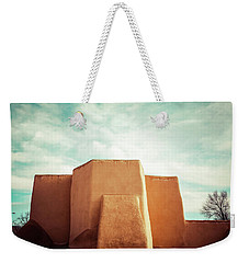 Weekender Tote Bag featuring the photograph Iconic Church In Taos by Marilyn Hunt