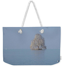 Weekender Tote Bag featuring the photograph Icy Isolation by Christin Brodie