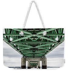 Weekender Tote Bag featuring the photograph Icy Mackinac Bridge In Winter by John McGraw