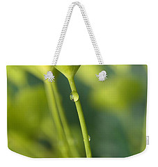 Weekender Tote Bag featuring the photograph In A Forest Of Spurge  by Connie Handscomb