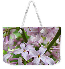 Weekender Tote Bag featuring the photograph In A Sea Of Lilacs by Kathi Mirto