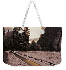 Weekender Tote Bag featuring the photograph In Between Snow Falls by Walter Fahmy