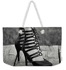 Weekender Tote Bag featuring the photograph In Black Heels by Ester Rogers