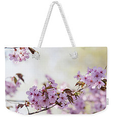 Weekender Tote Bag featuring the photograph In Bloom. Spring Watercolors by Jenny Rainbow