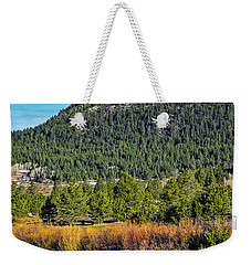 Weekender Tote Bag featuring the photograph In Colder Days by Nancy Marie Ricketts