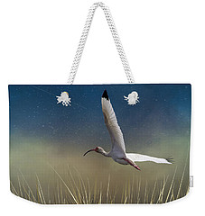 Weekender Tote Bag featuring the photograph In Flight 1 by Phil Mancuso