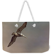 Weekender Tote Bag featuring the photograph In Flight 2 by Phil Mancuso