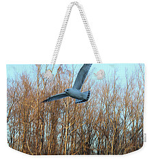 Weekender Tote Bag featuring the photograph In Flight by Melinda Blackman
