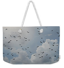 Weekender Tote Bag featuring the photograph In Flight by Rob Hans