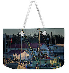 Weekender Tote Bag featuring the photograph In For Ice by Randy Hall