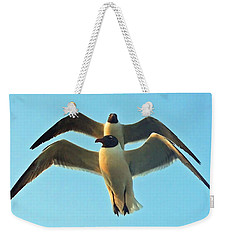 Weekender Tote Bag featuring the photograph In Tandem At Sunset by Sandi OReilly