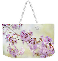Weekender Tote Bag featuring the photograph In Tender Bloom. Spring Watercolors by Jenny Rainbow