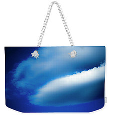Weekender Tote Bag featuring the photograph In The Air by Eric Christopher Jackson