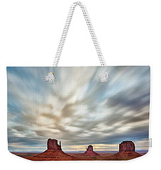 Weekender Tote Bag featuring the photograph In The Clouds by Jon Glaser