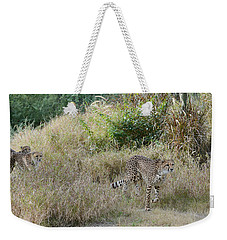 Weekender Tote Bag featuring the photograph In The Lead by Fraida Gutovich