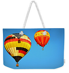 Weekender Tote Bag featuring the photograph In The Shadow by AJ Schibig