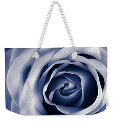 Weekender Tote Bag featuring the photograph Indigo Rose by Jim Hughes