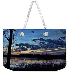 Weekender Tote Bag featuring the photograph Indigo Skies by Cricket Hackmann