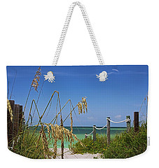 Weekender Tote Bag featuring the photograph Indulging In Memories by Michiale Schneider