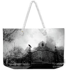 Weekender Tote Bag featuring the photograph Infrared Gothic Raven On Gate Black And White Infrared Print - Solitude - Gothic Raven Infrared Art  by Kathy Fornal