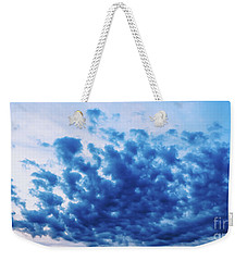 Weekender Tote Bag featuring the photograph Ink Blot Sky by Colleen Kammerer