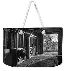Weekender Tote Bag featuring the photograph Inside The Horse Barn Black And White by Edward Fielding