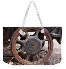 Weekender Tote Bag featuring the photograph Iron Train Wheel by Aidan Moran