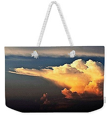 Weekender Tote Bag featuring the photograph Is Something Brewing Out There by John Glass