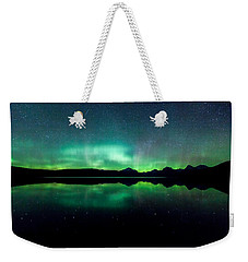 Weekender Tote Bag featuring the photograph Iss Aurora by Aaron Aldrich