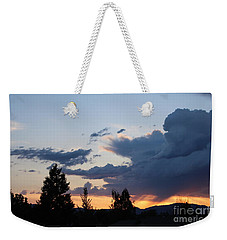 Weekender Tote Bag featuring the photograph It Cometh by Marie Neder