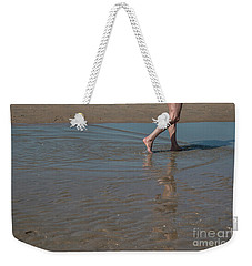 Weekender Tote Bag featuring the photograph It Only Takes One by Ana Mireles