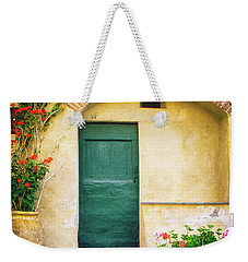 Weekender Tote Bag featuring the photograph Italian Facade With Geraniums by Silvia Ganora