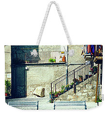 Weekender Tote Bag featuring the photograph Italian Square With Benches by Silvia Ganora
