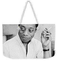 Weekender Tote Bag featuring the photograph James Baldwin by Granger
