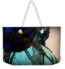 Weekender Tote Bag featuring the photograph Japanese Glass Floats by Katie Wing Vigil