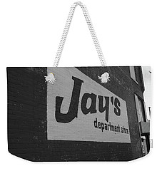 Weekender Tote Bag featuring the photograph Jay's Department Store In Bw by Doug Camara