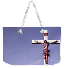 Weekender Tote Bag featuring the photograph Jesus Crucifix Against The Sky by Gary Whitton