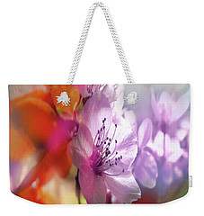 Weekender Tote Bag featuring the photograph Juego Floral by Alfonso Garcia