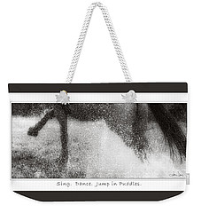 Weekender Tote Bag featuring the photograph Jump In Puddles by Joan Davis