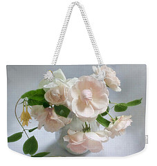 Weekender Tote Bag featuring the photograph June Roses With Honeysuckle by Louise Kumpf