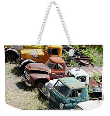 Weekender Tote Bag featuring the photograph Junkyard Rainbow by Suzanne Oesterling