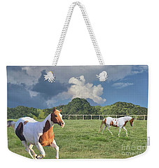Weekender Tote Bag featuring the photograph Just Running by Janette Boyd