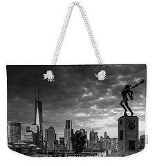 Weekender Tote Bag featuring the photograph Katyn New World Trade Center In New York by Ranjay Mitra