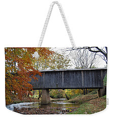 Weekender Tote Bag featuring the photograph Kissing Bridge At Fall by Eric Liller