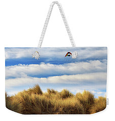 Weekender Tote Bag featuring the photograph Kite Over The Hill by James Eddy